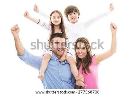 Excited family with arms raised  - stock photo