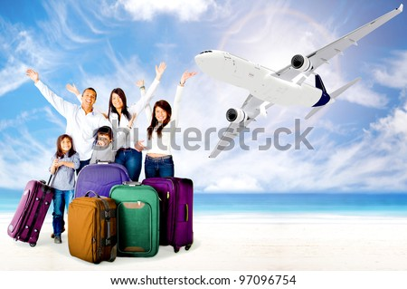 Excited family with arms up enjoying their vacations - stock photo