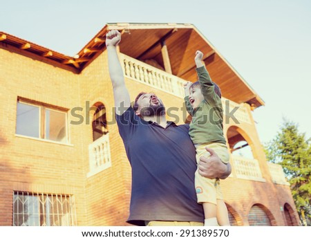 Excited father and son - stock photo