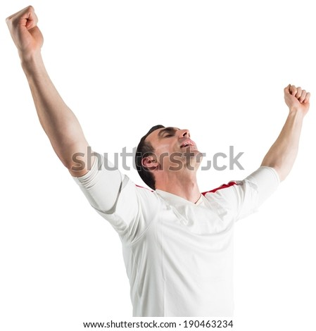 Excited football fan cheering on white background - stock photo