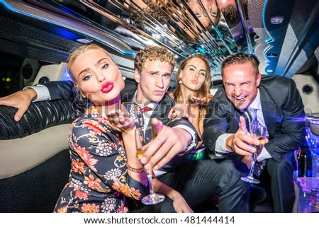 Excited Friends Gesturing Towards You In Limousine During Party