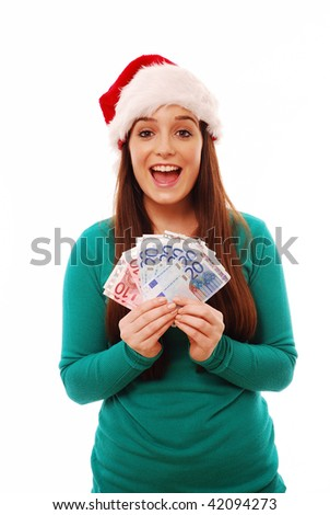 Excited girl holding Euros in santa hat on white background - stock photo