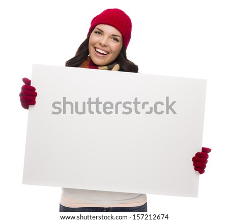 Excited Girl Wearing Winter Hat and Gloves Holds Blank Sign Isolated on White Background. - stock photo