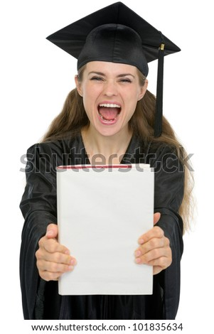 Excited graduation girl student showing book