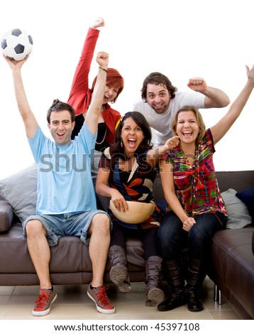 Excited group of people watching football at home - stock photo