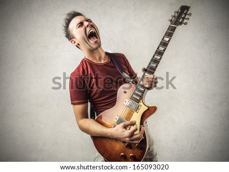 Excited Guitarist - stock photo