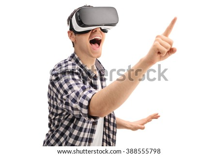 Excited guy using a VR headset and touching something isolated on white background - stock photo