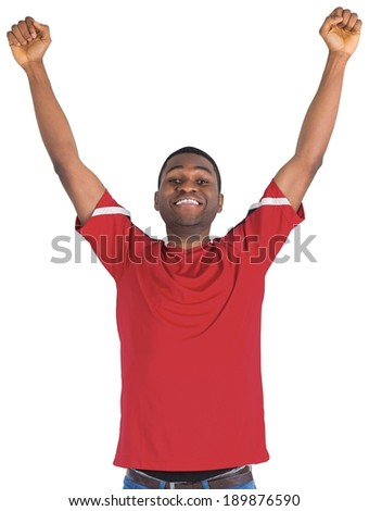 Excited handsome football fan cheering on white background