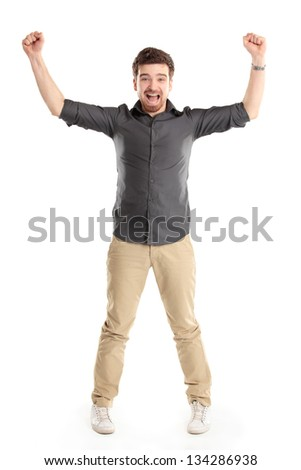 Excited handsome man with arms raised in success - Isolated on white - stock photo