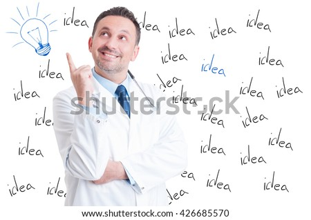 Excited handsome successful doctor pointing a great idea or having a revelation on white background with lightbulb above his head - stock photo