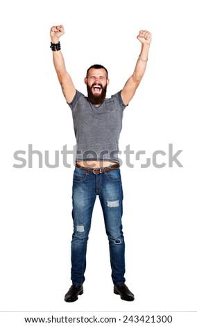 Excited handsome Tattooed bearded man with arms raised in success - Isolated on white - stock photo