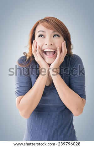 Excited happy Asian girl face, closeup portrait. - stock photo