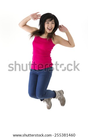 Excited & happy Asian woman jumping for joy. Chinese ethnicity, isolated on white background.  - stock photo