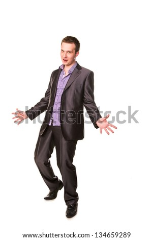 Excited happy businessman  with arms raised in success isolated on white
