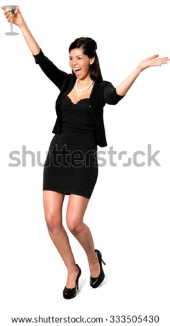Excited Hispanic young woman with long dark brown hair in casual outfit holding martini glass - Isolated