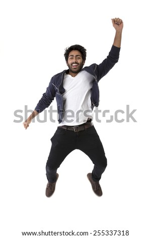 Excited Indian man jumping for joy. Isolated on white background. - stock photo