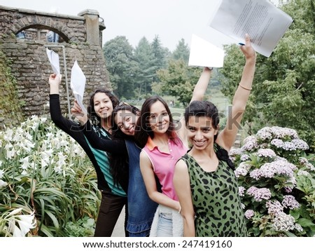 Excited Indian students after finishing off their examination. - stock photo