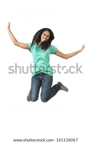 Excited Indian woman jumping for joy. Beautiful Asian woman jumping isolated on white background.