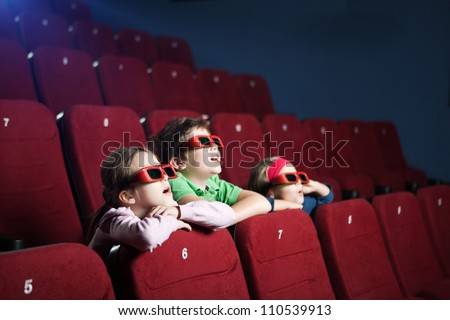 Excited kids watching cartoon in the 3D movie theater