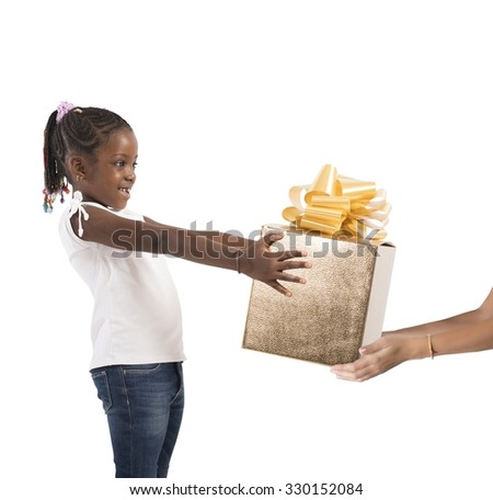 Excited little girl receives an unexpected present - stock photo