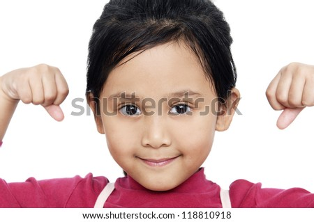 Excited little girl with arms raised