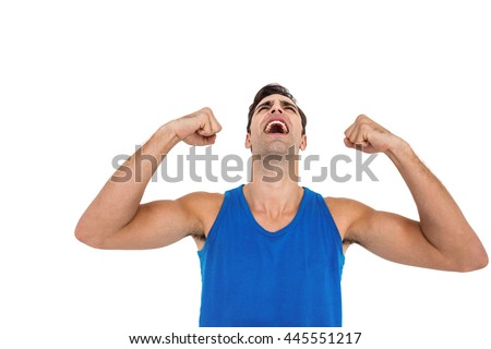 Excited male athlete posing after victory on white background