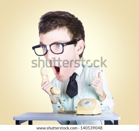 Excited male employee of the month shouting out with enthusiasm and excitement when communicating to customers with his enlarged head - stock photo