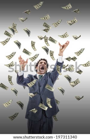 excited man catching money falling around him, businessman under money rain, yelling man reaching for flying banknotes - stock photo