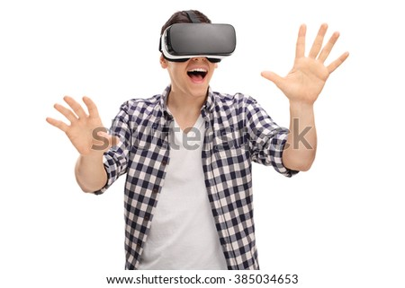 Excited man experiencing virtual reality via VR headset and touching something with his hands isolated on white background