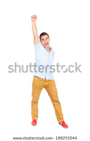 excited man happy smile, hold arm hand fist raised up gesture, young guy wear shirt, full length isolated over white background - stock photo