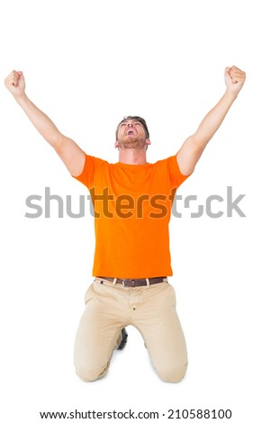 Excited man in orange cheering on white background