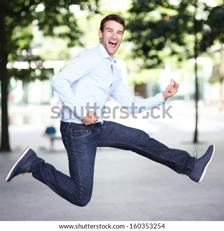Excited man jumping  - stock photo