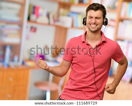 Excited Man Listening Music On Headphone