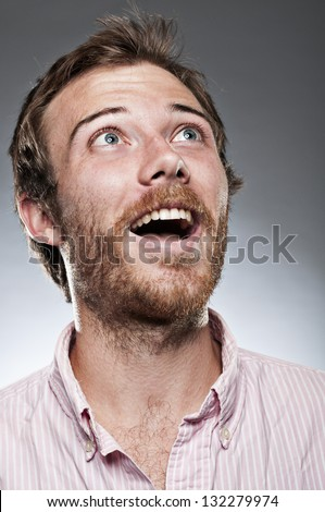 Excited Man Looking Up - stock photo
