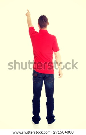 Excited man pointing on copy space - stock photo