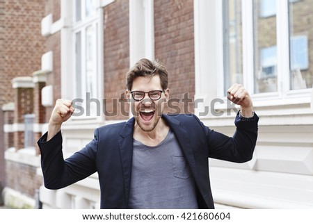 Excited man wearing spectacles, portrait - stock photo