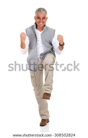 excited middle aged man holding fists on white background - stock photo