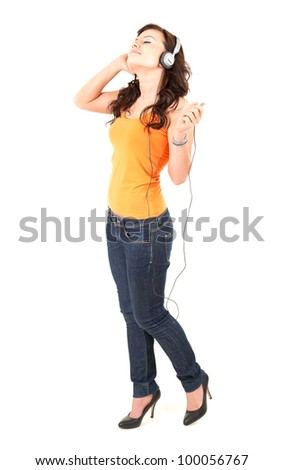 excited music young woman in headphones, white background