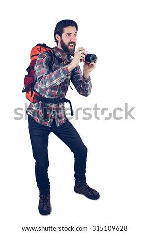 Excited photographer talking picture through camera - stock photo