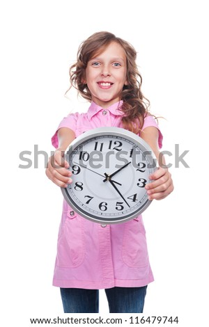 excited pretty girl holding the clock. studio shot over white background - stock photo