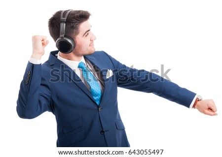 Excited salesman listening his favorite music on headphones isolated on white background