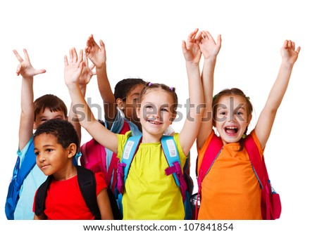 Excited school aged kids with backpacks - stock photo