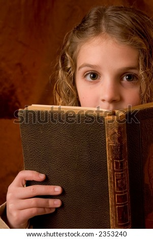 Excited school girl - stock photo