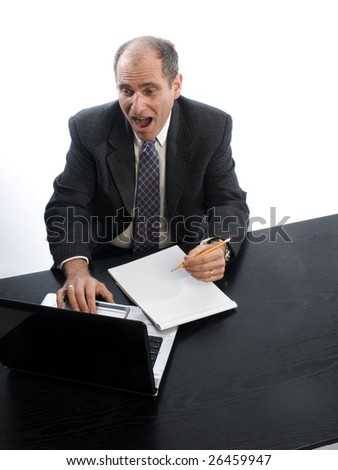 excited senior executive in office desk middle age man