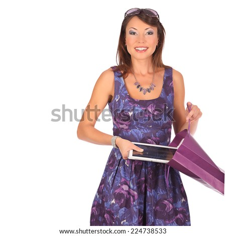 Excited shopping woman looking into bag and get present, isolated on white