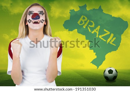 Excited south korea fan in face paint cheering against football pitch with brazil outline and text - stock photo