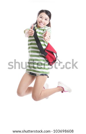 Excited student girl jumping and good hand gesture with bag in full length - isolated over white background, model are asian woman - stock photo