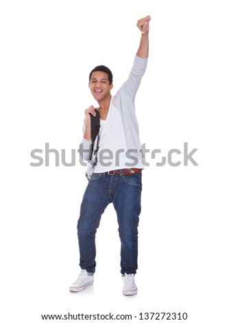 Excited Student Man Isolated Over White Background - stock photo