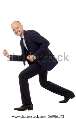 Excited successful business man isolated over white