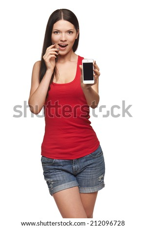 Excited surprised woman showing cell phone with black screen over white background - stock photo